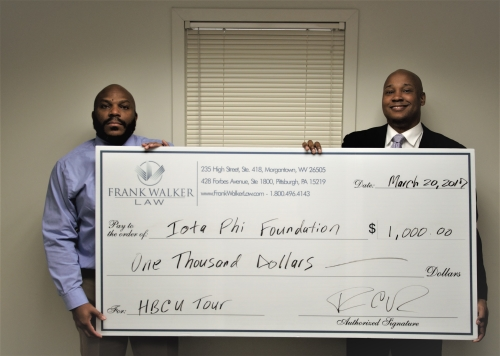 Attorney Frank Walker Presents the Donation Check to his Omega Psi Phi Fraternity Brother Michael Harrell for the HBCU College Tour